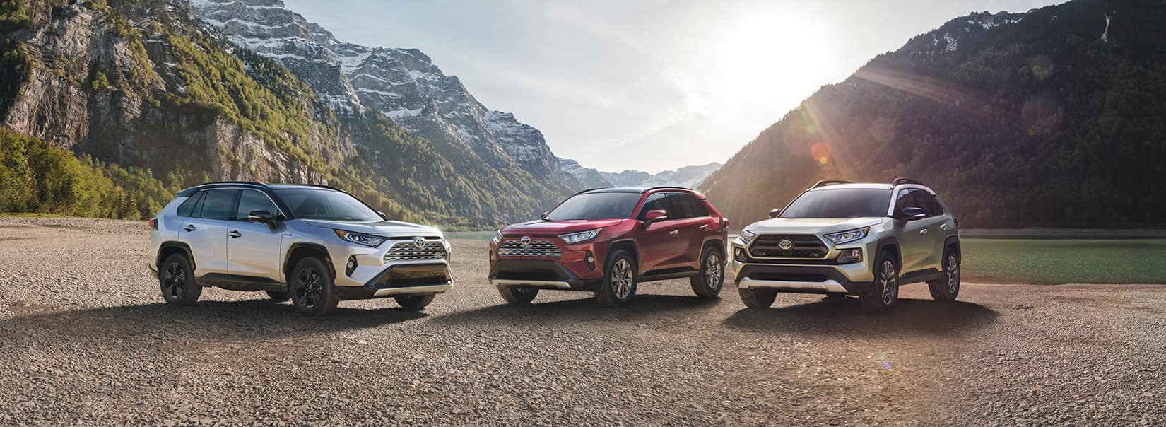Halterman's Toyota is a Toyota Dealership near Brodheadsville, PA   Three 2020 Toyota RAV4s parked with mountains in the background