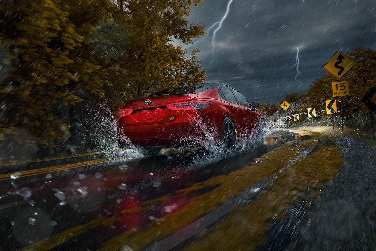 Accessories that help keep your Toyota protected at Halterman's Toyota in East Stroudsburg   2021 Toyota Camry driving through wet roads in the rain