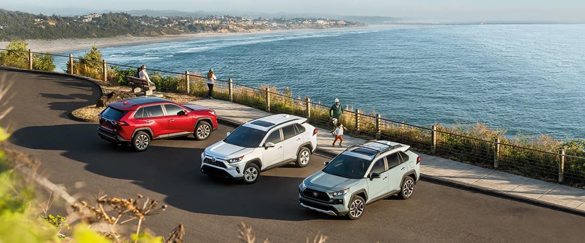 Halterman's Toyota is a Toyota Dealership near Easton, PA   Three 2020 Toyota RAV4s parked by the beach