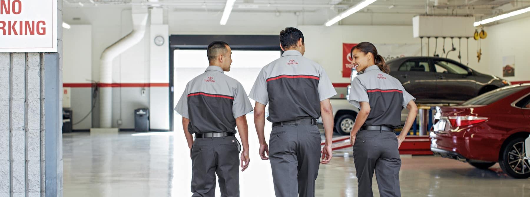 Halterman's Toyota is a Toyota Dealership near Saylorsburg, PA | Toyota Service Technicians walking together in garage
