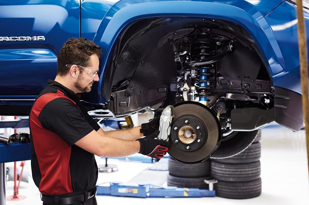 Halterman's Toyota is a Toyota Dealership near Arlington Heights PA | Toyota mechanic fixing brakes on a truck