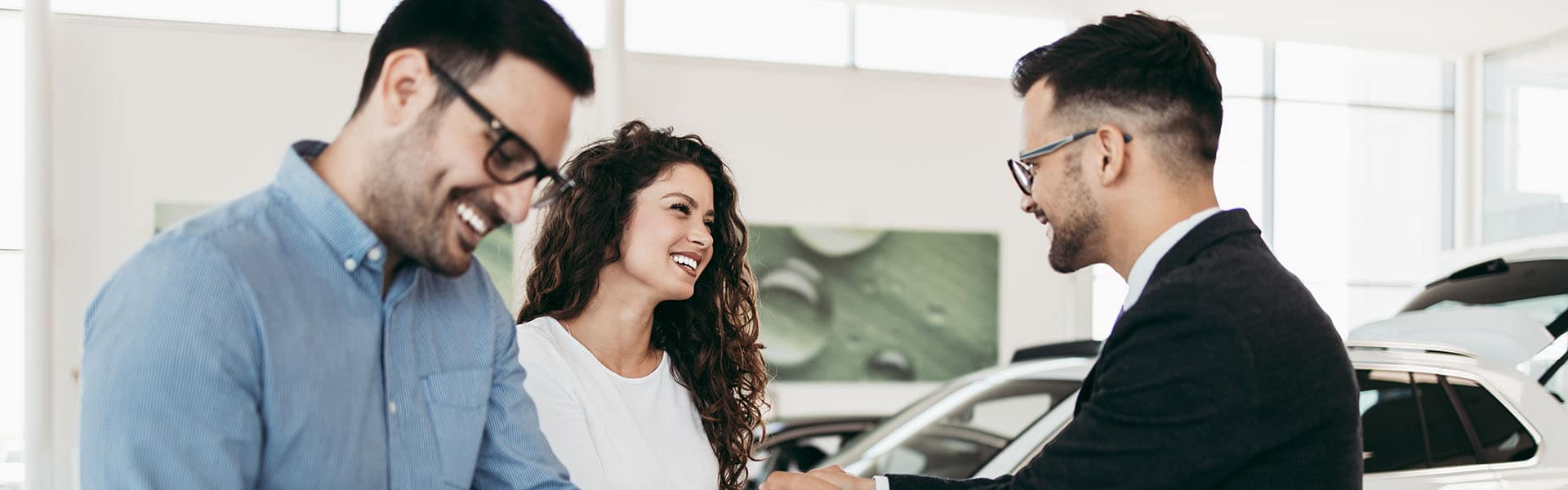 Middle age couple choosing and buying car at car showroom. Car s