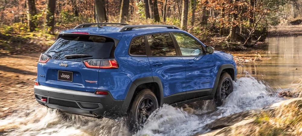 blue-jeep-cherokee-driving-through-water