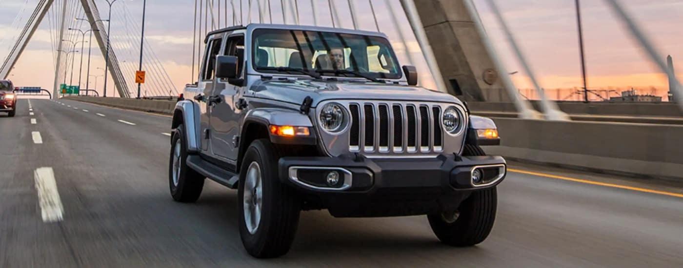 jeep-driving-on-city-bridge