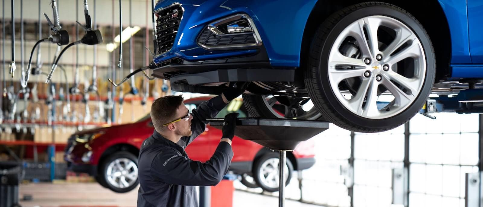 A technician performing an oil change