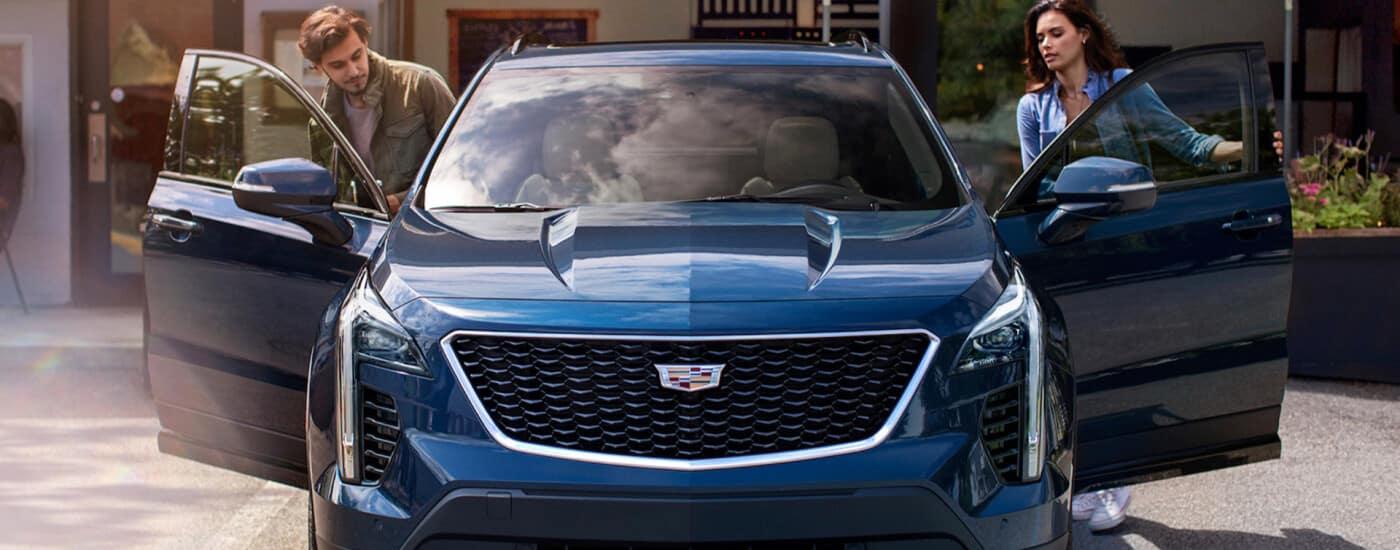 Couple going into a 2020 Cadillac