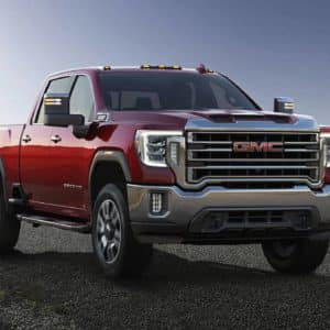 2020 GMC Sierra HD speeding down a deserted road