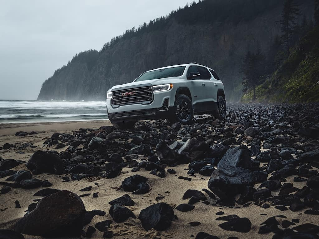 GMC Acadia on beach white