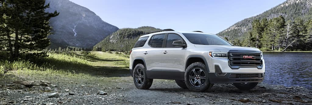 white GMC Acadia near river