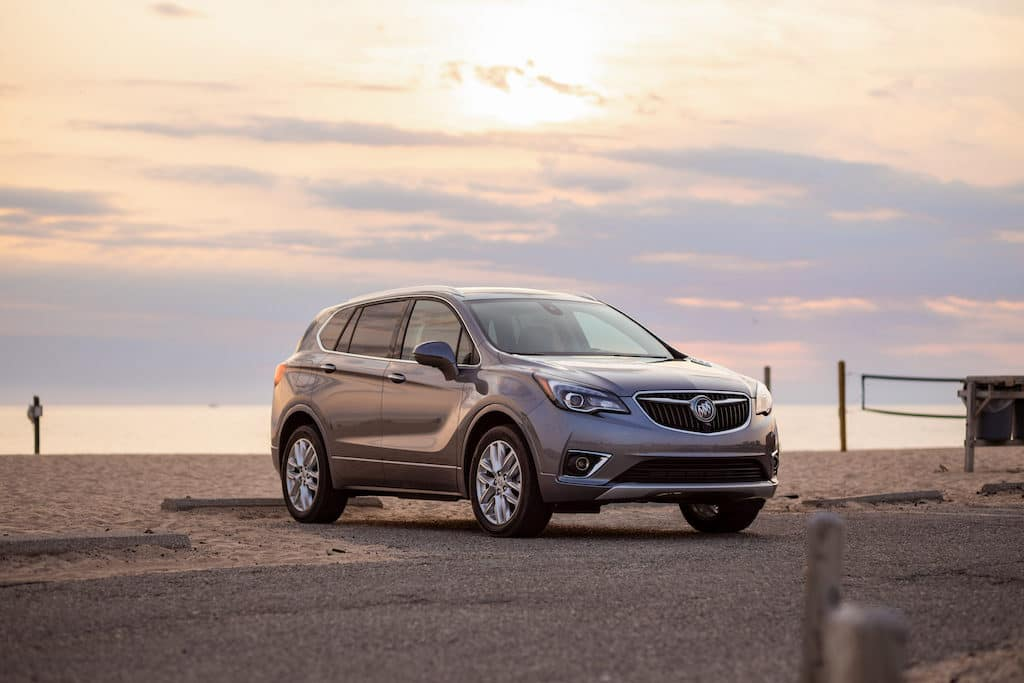 silver buick envision at beach