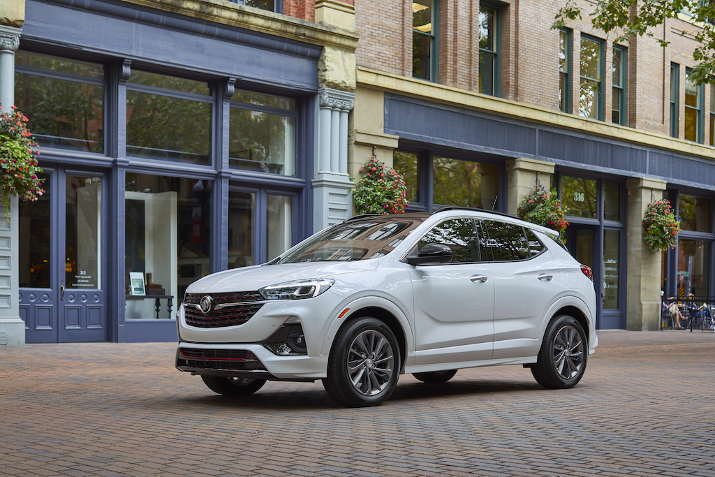 2021 Encore GX Essence (1SL) exterior in White Frost Tricoat. Shown with RQJ wheels, Sport Touring Package, Convenience Package and Black Roof Package.