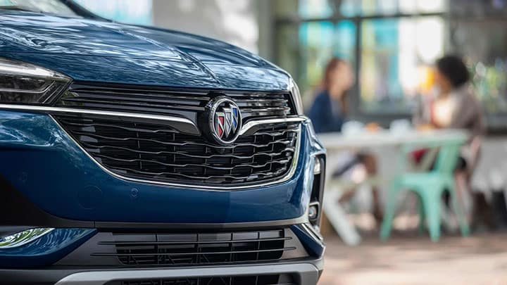 2021 Encore GX Essence (1SL) exterior in Deep Azure Metallic. Showing the front grille detail.