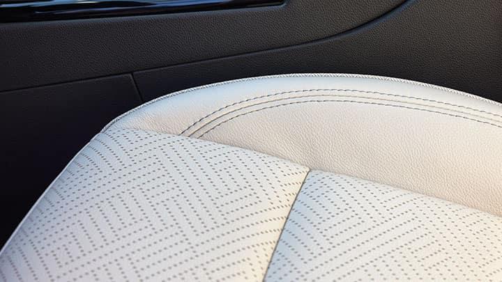 2021 Encore GX Essence (1SL) interior shown in Whisper Beige.