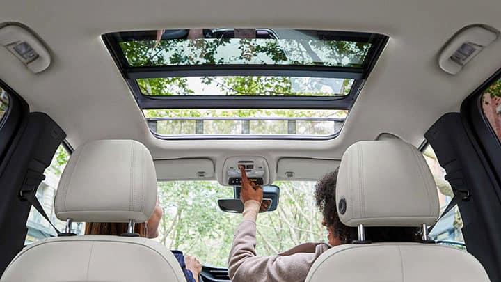 2021 Encore GX Essence (1SL) sun roof. Interior shown in Whisper Beige.