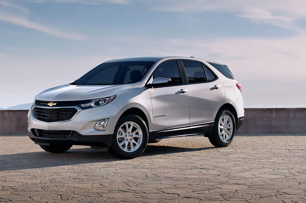 Chevrolet Equinox LS [1LS] in Summit White with open sky backdrop. 3/4 Driver's Side Front.