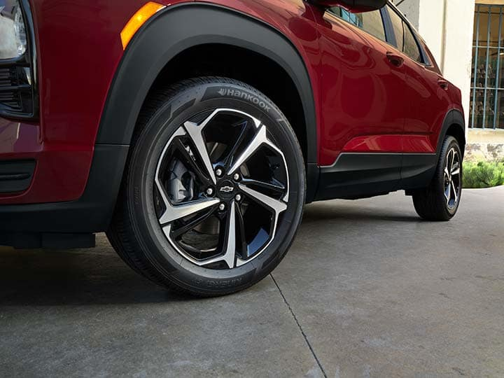 2021 Chevrolet Trailblazer RS Interior photography showing RS 18-Inch Alloy Wheel. Exterior color shown is Agate Red w/ Black Roof (GIL/J35).