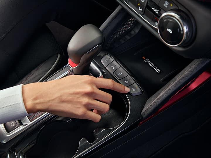 2021 Chevrolet Trailblazer RS interior photography showing AWD Button. Interior is shown in Jet Black Vinyl (HSL)