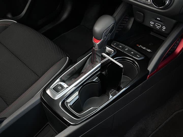 2021 Chevrolet Trailblazer RS interior; center console phone slot with Samsung phone. Interior is shown in Jet Black Vinyl.
