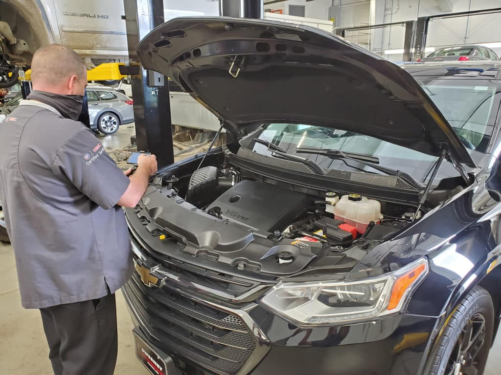 Doing a routine inspection for a customer following an oil change.