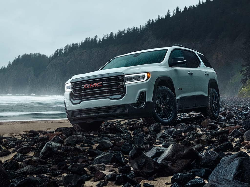"""2021 GMC Acadia AT4 AWD in Summit White with (Q7D) 17"""" Machined Aluminum Wheels; Shown with Accessory Roof Rack Cross Rails; 3/4 Drivers side Front"""