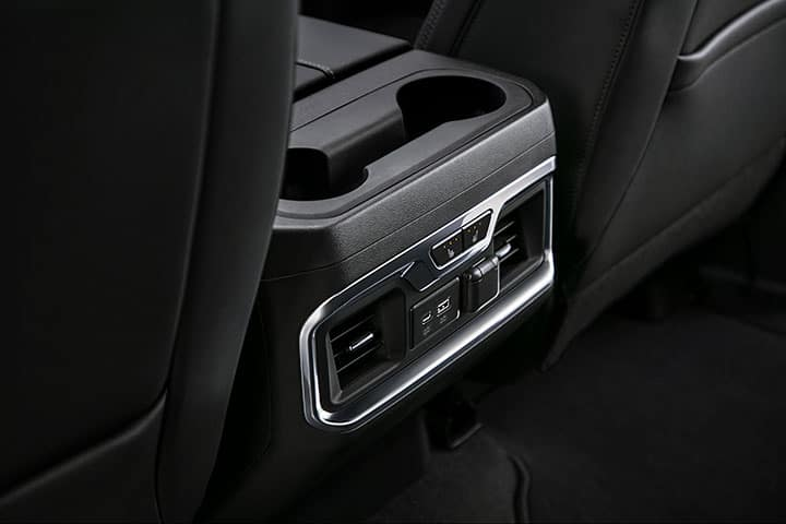 2021 GMC Sierra 1500 SLT Interior in Jet Black; Detail Shot of Rear Center Console HVAC, Heated Seat Controls and USB Outlets.