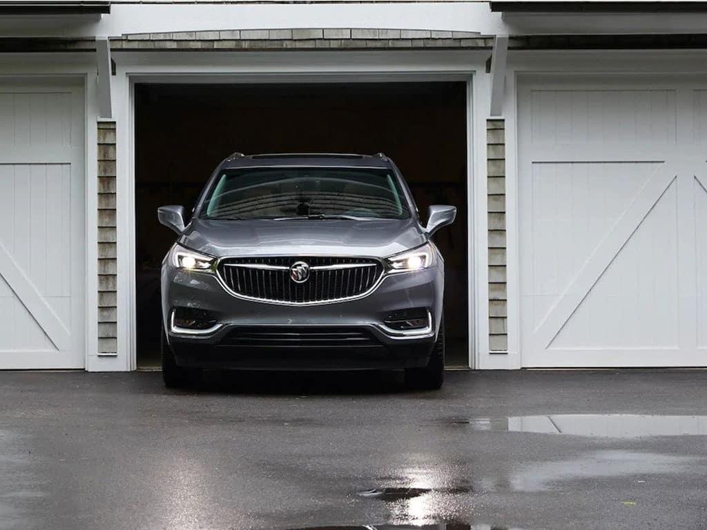 2021 Buick Enclave Premium (1SN) in Satin Steel Metallic - head on shot of vehicle inside garage