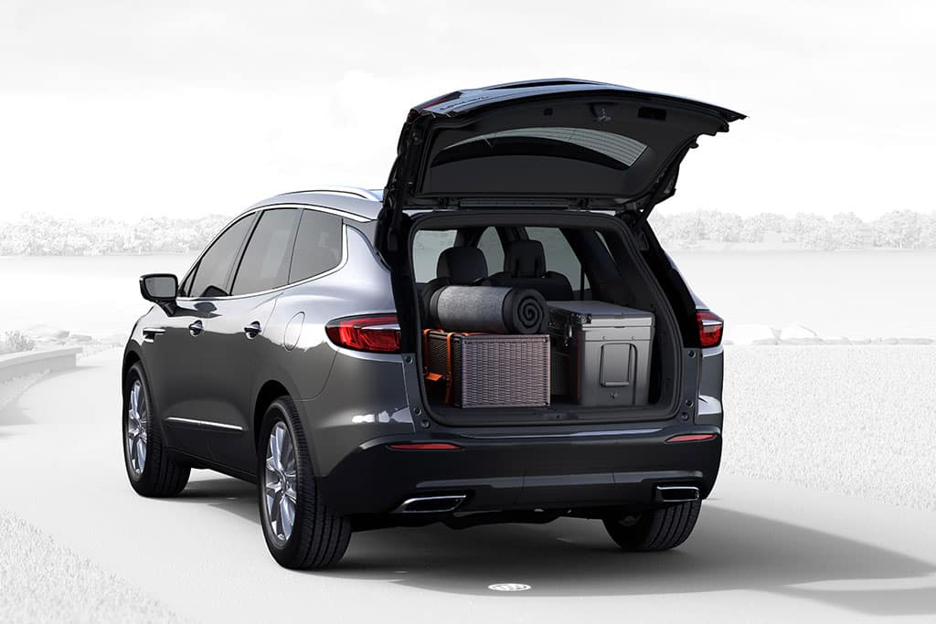 2021 Buick Enclave Premium (1SN). CGI - Rear 3/4 Drivers Side - rear hatch open showing trunk storage. Vehicle shown in Satin Steel Metallic with available 20 inches SQ7 wheels.