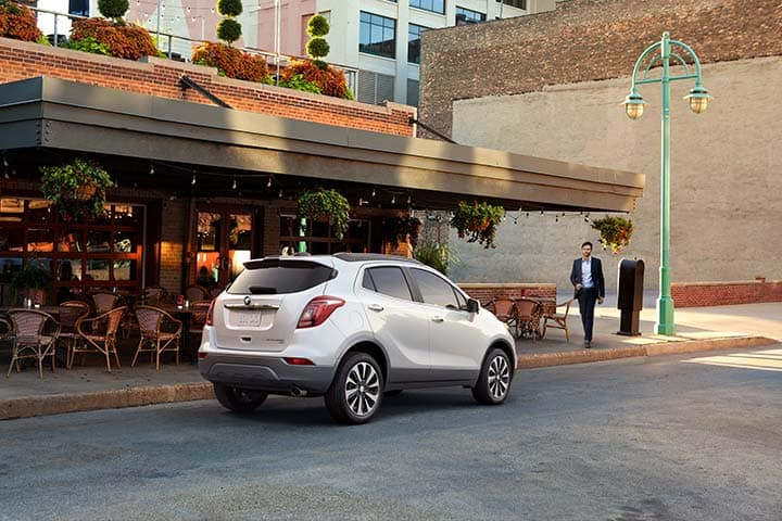 2021 Buick Encore Preferred (1SB) in White Frost Tricoat on city street