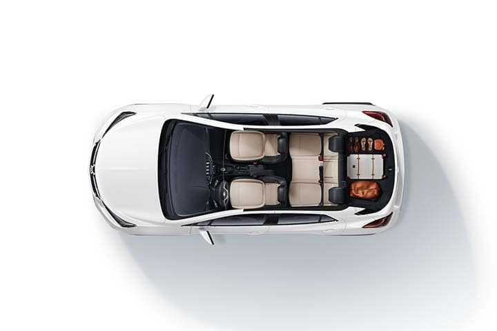 2021 Encore Preferred (1SB) in Summit White. Shown with Shale with Ebony accents interior. Luggage shown in trunk