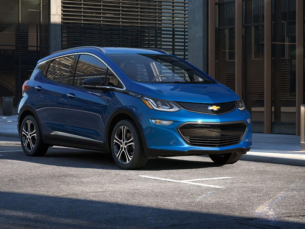 2021 Chevrolet Bolt EV Hatchback Premier in Kinetic Blue Metallic GD1 on city street