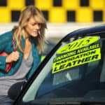 Young woman shopping for used cars